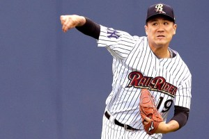 New York Yankees pitcher Masahiro Tanaka warms up in the outfield before pitching for the Scranton RailRiders against the Durham Bulls in a baseball game, Thursday, May 21, 2015, in Scranton, Pa. Tanaka is expected to throw 45 pitches in his first rehab start after missing almost a month with wrist tendinitis and a mild forearm strain. (AP Photo/Julie Jacobson)