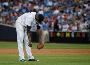 New York Yankees pitcher Michael Pineda reacts after giving up a two-run single to the Philadelphia Phillies during the third inning of a baseball game, Monday, June 22, 2015, in New York. (AP Photo/Julie Jacobson)