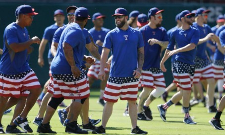 Texas Rangers' Mike Napoli, facing front at center, laughs with teammates as they runs onto the field during a baseball team workout in Arlington, Texas, Tuesday, Oct. 6, 2015. (AP Photo/LM Otero) ORG XMIT: TXMO102